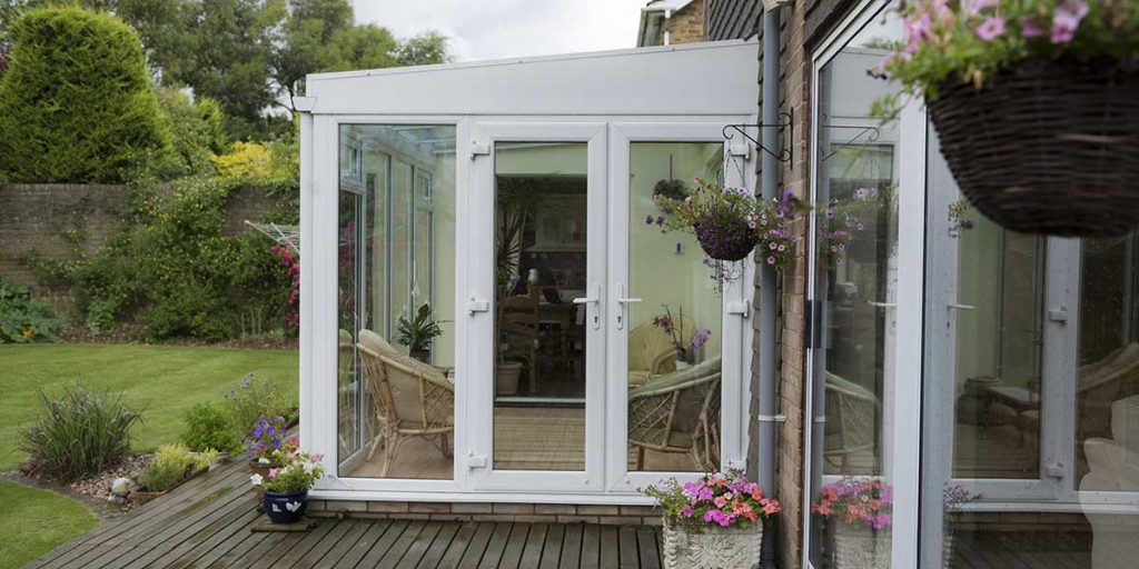 White Lean-To Conservatory with French Doors